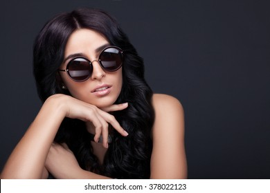 Beautiful woman in trendy round sunglasses