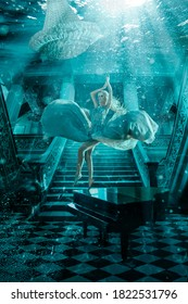 Beautiful woman underwater with piano