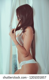 Beautiful woman in underwear. Window light