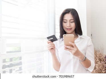 beautiful woman use mobile and credit card for shopping online