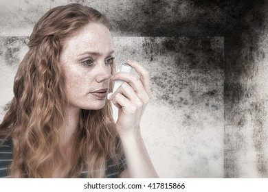 Beautiful woman using the asthma inhaler against image of room corner