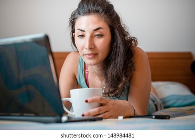 beautiful woman using notebook at home