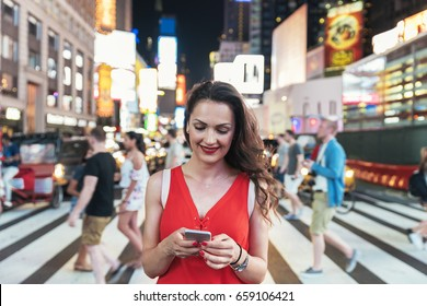 Beautiful woman using phone in Times Square. New York.