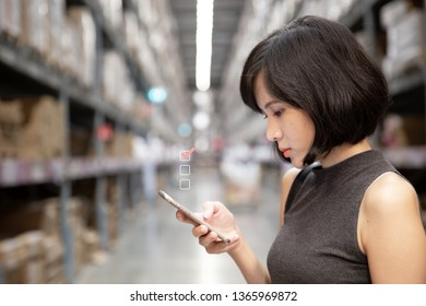 A beautiful woman using smart phone with a  check mark icon at the warehouse, searching or social networks concept, hipster lady typing an sms message.