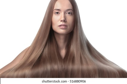 Beautiful Woman with very long hair and serene face. Front view Portrait in High Key technique of beauty Haircut Concept. Fashion Model isolated on white background