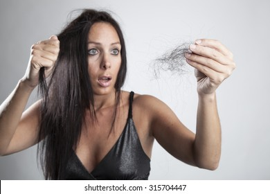 Beautiful woman is very unhappy with her hair loss