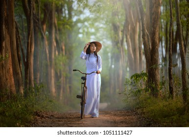 Beautiful  woman with Vietnam culture traditional dress on during sunset,Vietnam