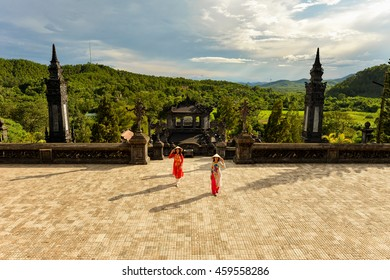 Beautiful  woman with Vietnam culture traditional ,vintage style,Grand stairs in Imperial Khai Dinh Tomb in Hue, Vietnam