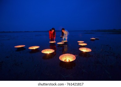 Beautiful  woman with Vietnam culture traditional dress on during sunset,focus on candle,Vietnam