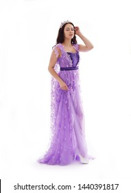 beautiful woman in violet dress and crown, lace gown