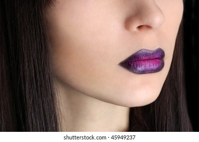 Beautiful woman with violet make-up