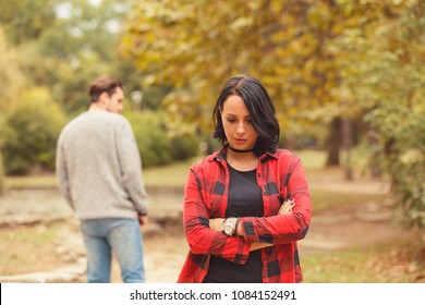 Beautiful woman waiting for boyfriend outdoors. Love or break up concept.