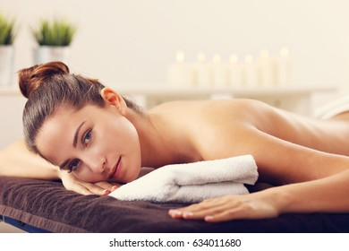 Beautiful woman waiting for massage in spa