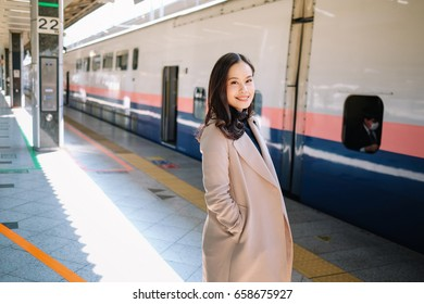 Beautiful woman waiting for a train on the platform.