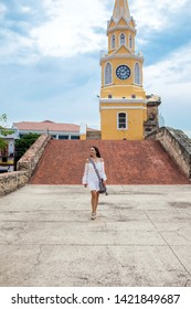 Beautiful woman walking around Cartagena de Indias next to the famous Clock Tower