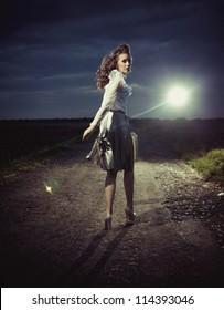 Beautiful woman walking away