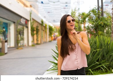Beautiful woman walking in the summer city