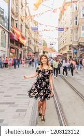 Beautiful woman walks at Istiklal street,a popular location in Beyoglu district,Istanbul,Turkey