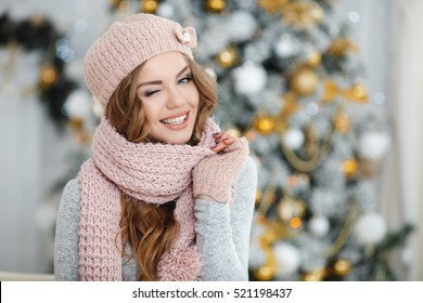 beautiful woman in warm clothing on christmas tree background. Very  beautiful girl with blue eyes 6e9e0d7b9ab9