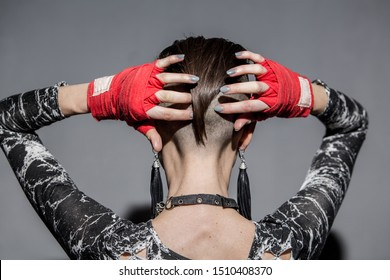 Beautiful woman with warrior makeup and boxing tape for punching
