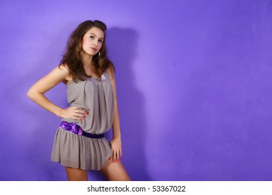 Beautiful woman wearing beige dress