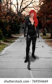 Beautiful woman wearing a black vinyl rubber latex cat suit