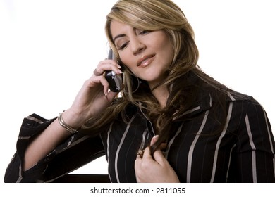 beautiful woman  wearing businesss wear and talking on the phone