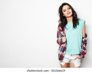 beautiful woman wearing casual clothes, posing on white backgrou