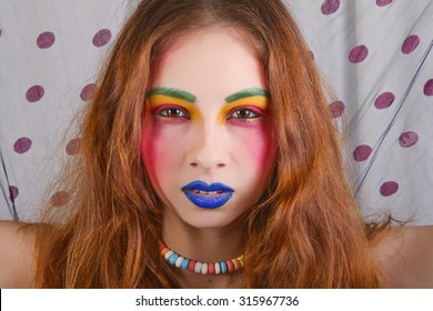 Beautiful Woman Wearing Colorful and Bright Makeup