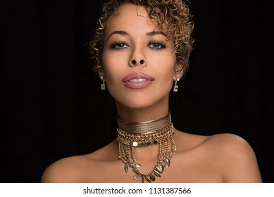 Beautiful Woman Wearing a Gold Chocker Necklace - Isolated on Black Background