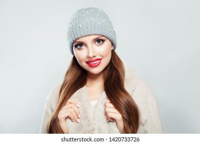 Beautiful woman wearing gray hat on white background