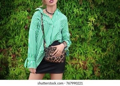 Beautiful woman wearing green in park