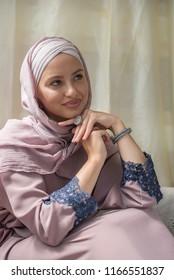beautiful woman wearing hijab sitting and relaxing