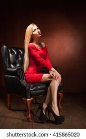 beautiful woman wearing red dress sitting