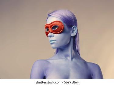 Beautiful woman wearing a red mask