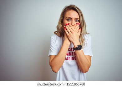 Beautiful woman wearing sacarstic comments loading t-shirt over isolated background shocked covering mouth with hands for mistake. Secret concept.