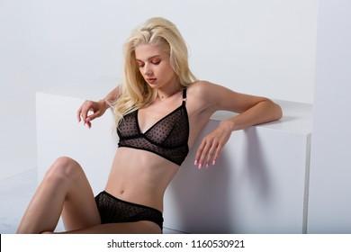 Beautiful woman wearing sexy black polka dot lingerie