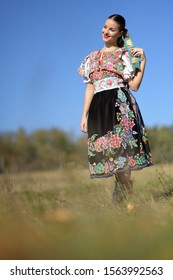 Beautiful woman wearing traditional folk costumes. Slovak folklore.