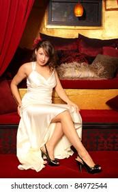 Beautiful woman wearing a white dress.