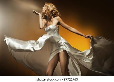 Beautiful woman wearing white dress