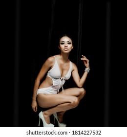Beautiful woman wearing white one-piece swimsuit