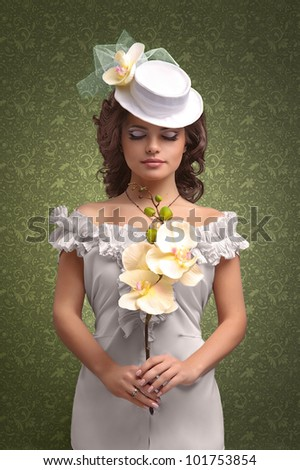 c5715ff915b8b beautiful woman in a wedding dress and white hat on a green textured  background