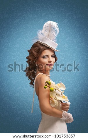 d0732bc8e9155 beautiful woman in a wedding dress and white hat on a blue textured  background
