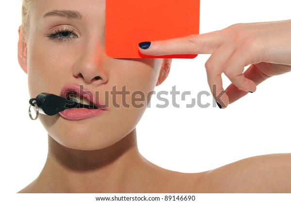 beautiful woman with whistle and red card isolated on white
