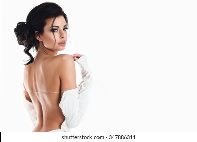 Beautiful woman in the white dress with naked back