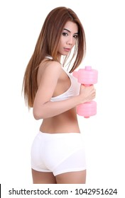 beautiful woman in white fitness clothes and her dumbbell
