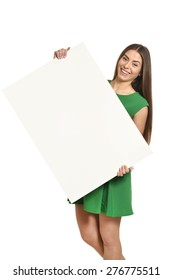 Beautiful woman and white signboard or copyspace for slogan or text, isolated over white background
