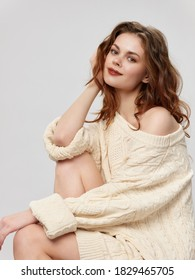 Beautiful woman in white sweater fashionable clothes makeup attractive look