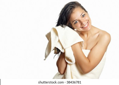Beautiful woman in white towel wipes her wet hair with a towel