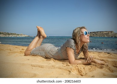 beautiful woman who is lying on the beach